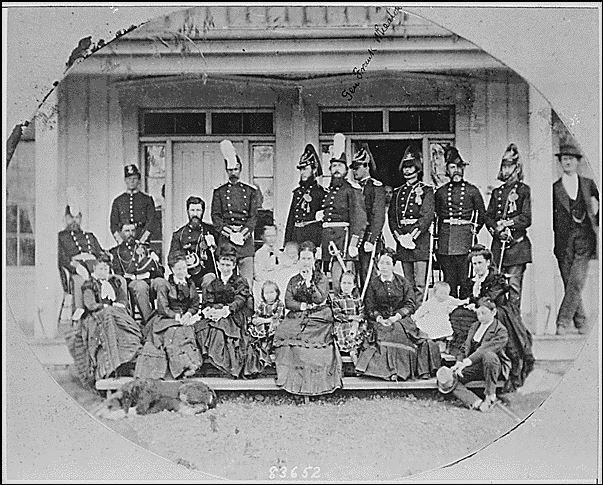 Historic photo of Fort Walla Walla with group outside front doors
